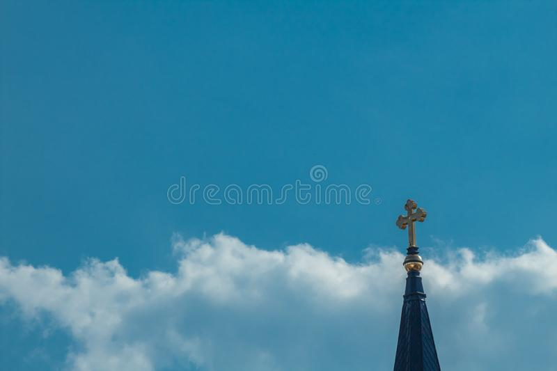 Crosses in the sky. A gold cross in a cloudy sky royalty free stock images