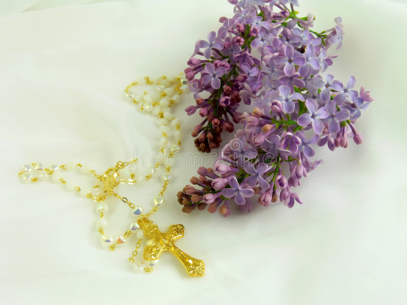 Gold cross and flower stock photo
