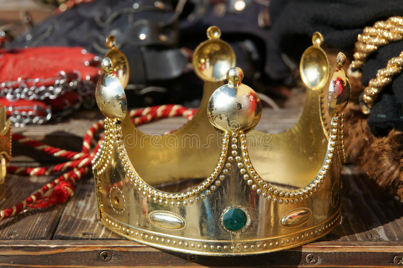 Gold crown. A gold king crown for sale on stand royalty free stock photos
