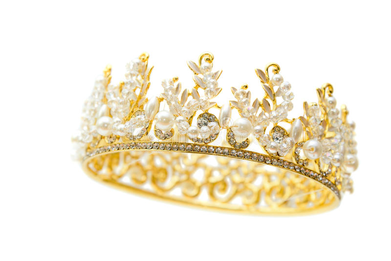 Gold crown of queen with pearl and white jewel of precious stone stock images