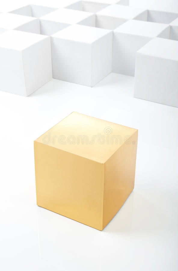 Gold cube stands out among white cubes royalty free stock photography
