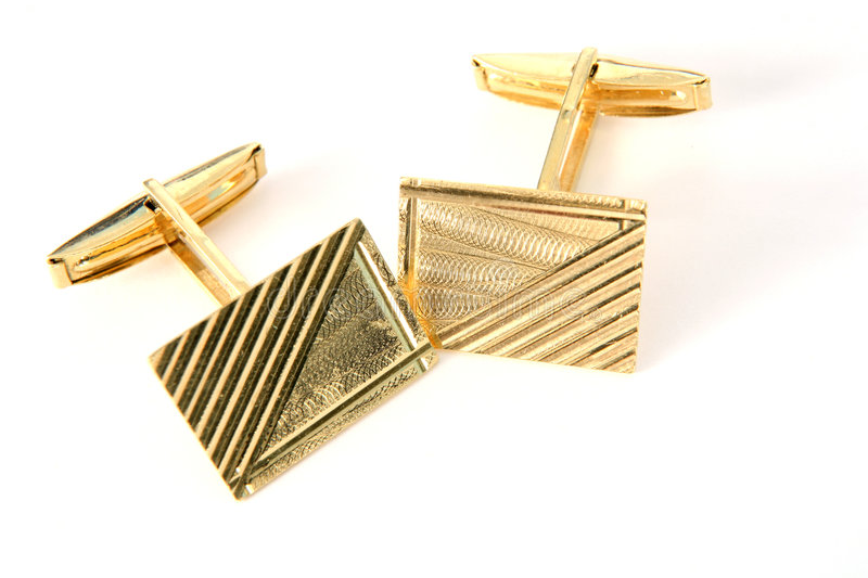 Gold cufflinks stock photos