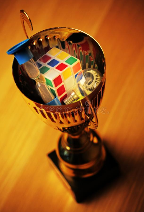 Gold cup sand clock bulb puzzle table stock images