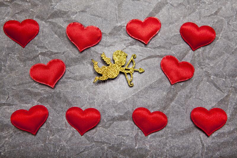 Gold cupid heart paper background. Studio stock images
