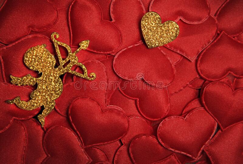 Gold cupid red heart background. Studio royalty free stock photo