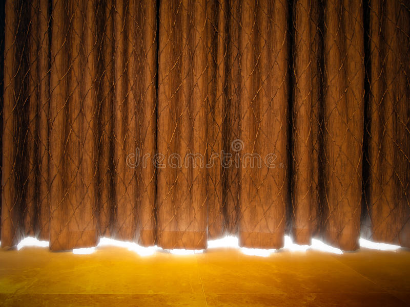 Gold curtains. With light from a stage stock image