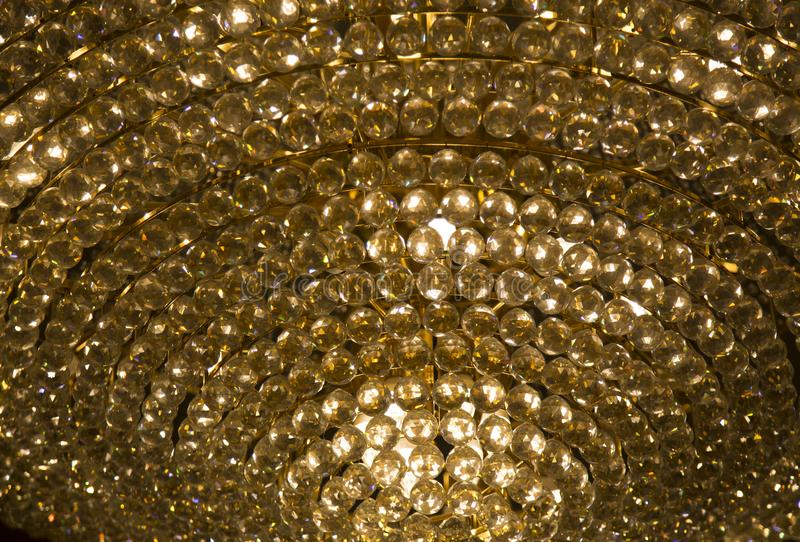Gold cystal glass ball with warm ligh in chadelier. Close up gold cystal glass ball with warm ligh in chadelier. Luuary in terior concept stock photo