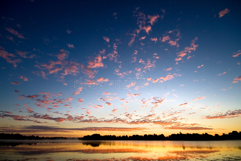 Gold dawn above lake stock images