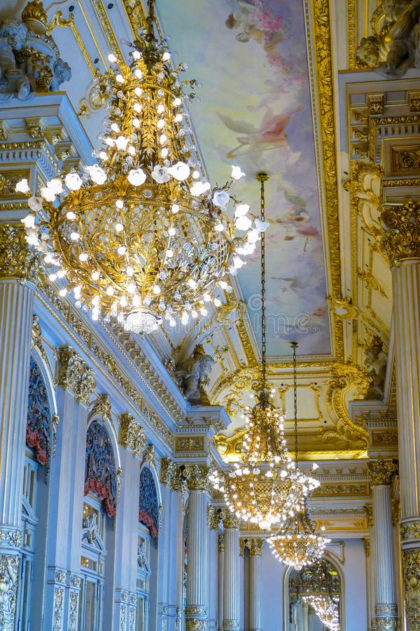Gold deco chandeliers royalty free stock photos