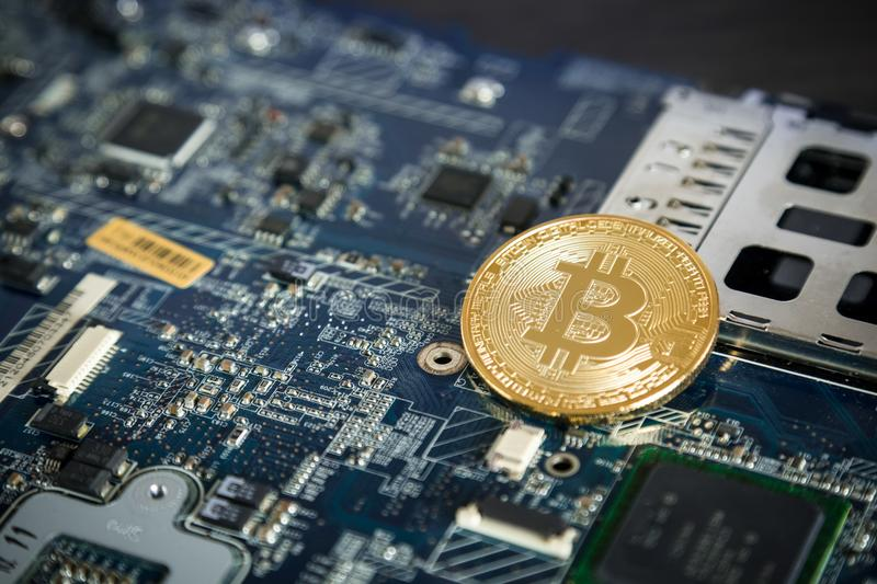Gold Digital Cryptocurrency Coin on Computer Motherboard. Bitcoin Mining Concept. Crypto Currency Background. stock images