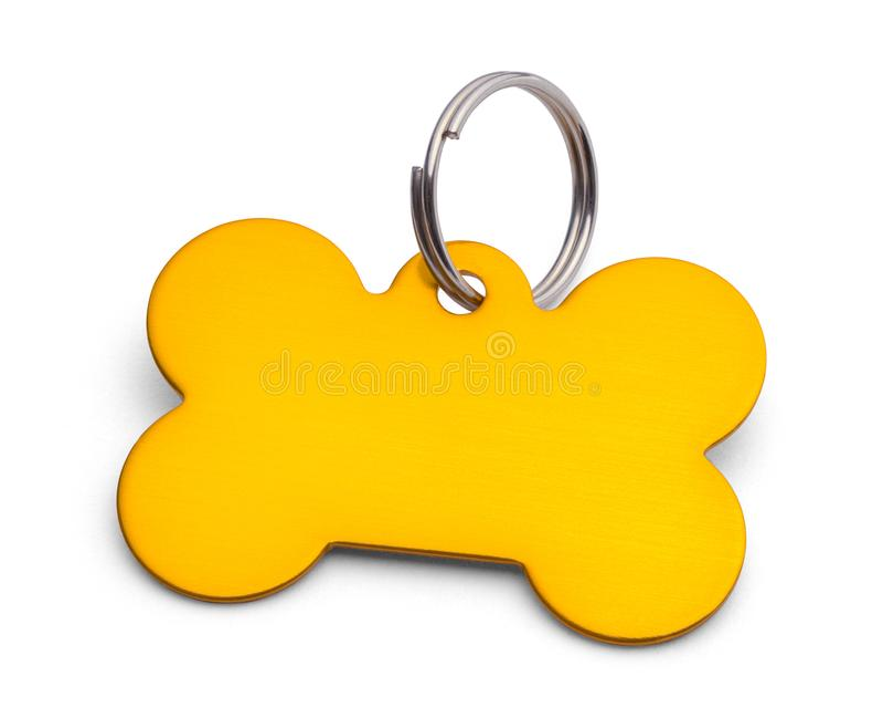 Gold Dog Bone Tag. Gold Bone Dog Tag Isolated on White stock photos