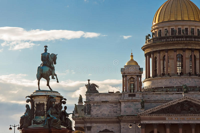 Gold dome of St. Isaac`s Cathedral in Saint-Petersburg, Monument to Nikolay the First stock photos