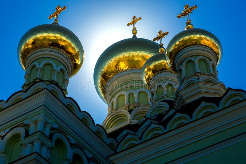 The gold domes with crosses on the roof. Gold domes with crosses on the roof of the Orthodox church, nobody royalty free stock photography
