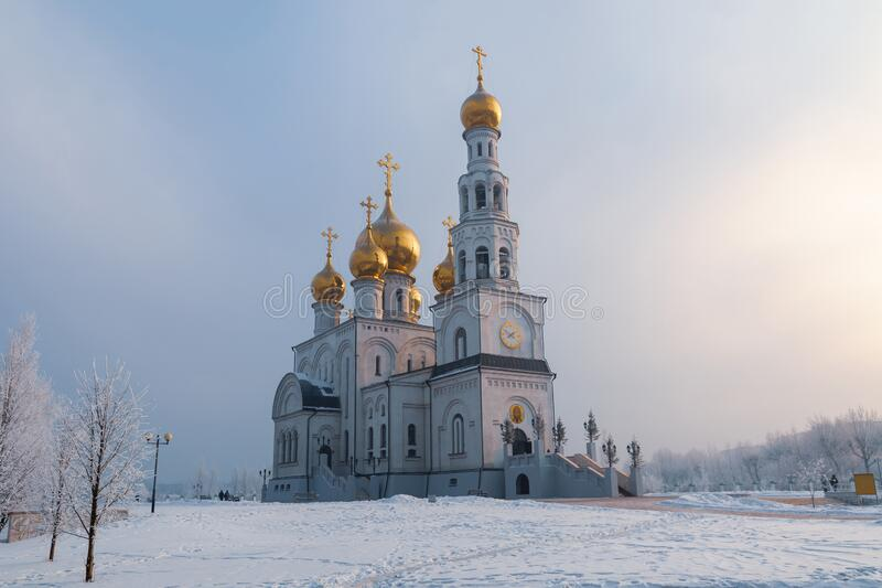 Gold domes of the Russian Orthodox Church. Savior Transfiguration Cathedral. Russia. Abakan stock photo