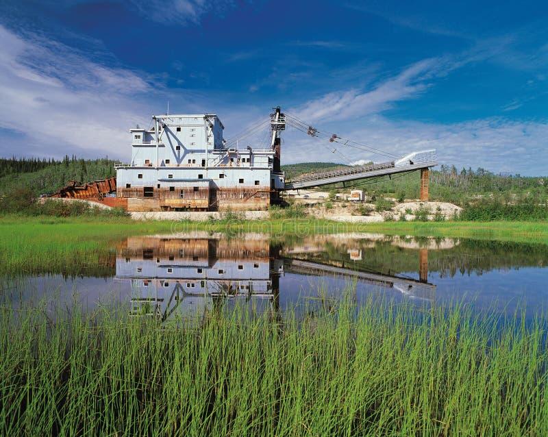 Gold Dredge at Bonanza Creek. Bonanza Creek and Gold Dredge at Yukon royalty free stock photography