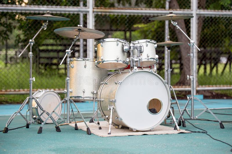 Gold drum set. On background blurred stock photos