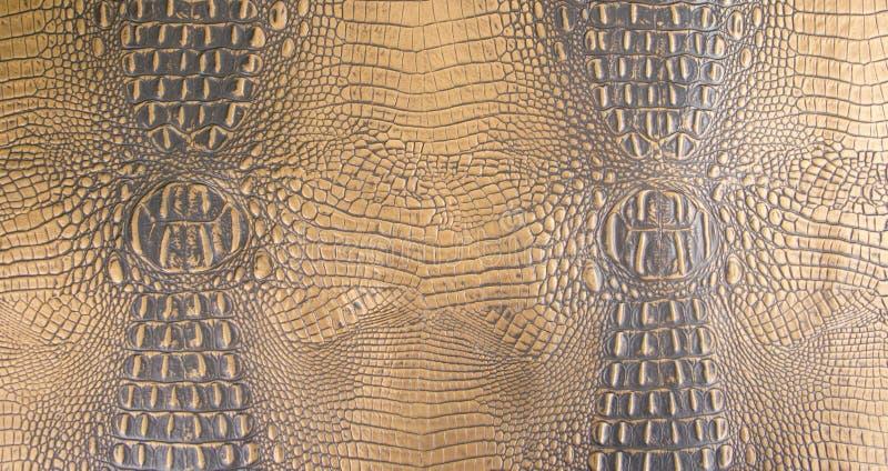 Gold/dunkle braunfarbige prägeartige Alligatorleder-Beschaffenheit stockfotos