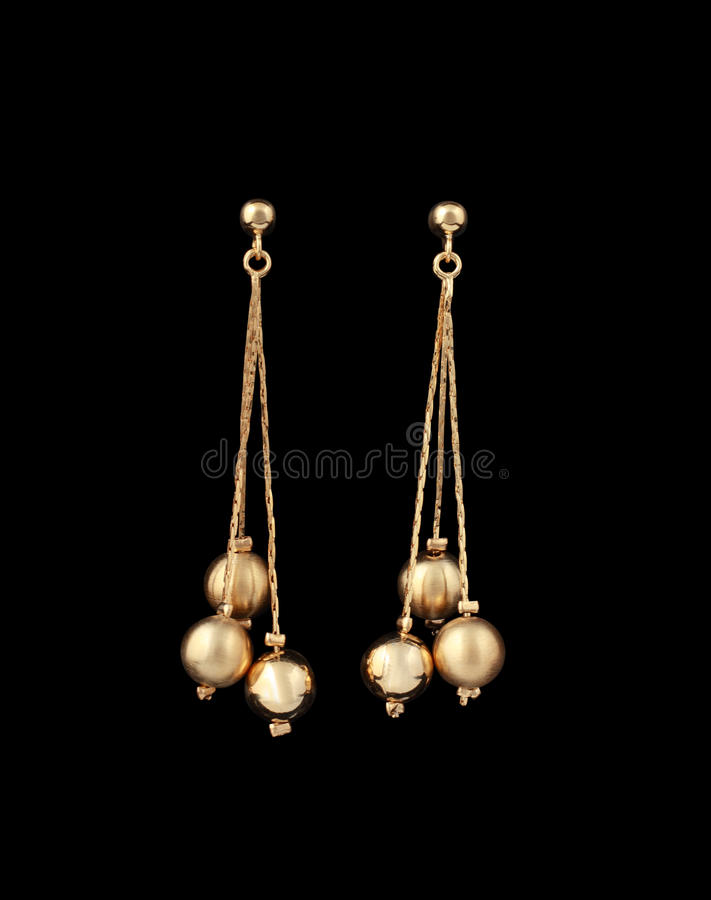 Gold Earrings Over Black Background Stock Image Image