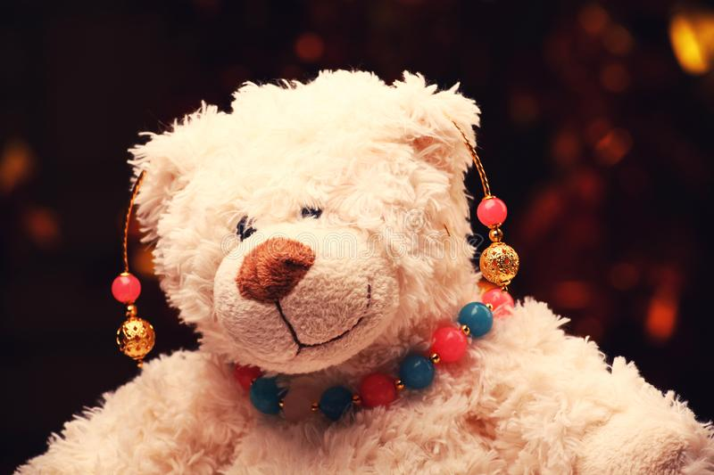 Gold earrings pink blue agate stone beads toy bear gold bokeh stock images