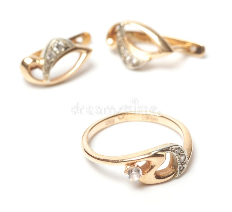 Gold earrings and ring stock photos