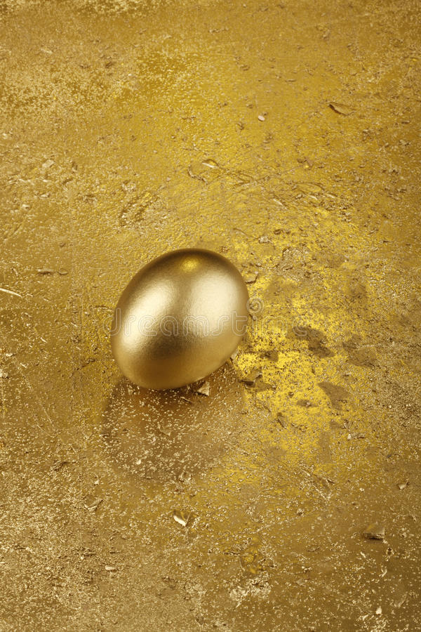 Gold Easter egg on a golden background stock photo