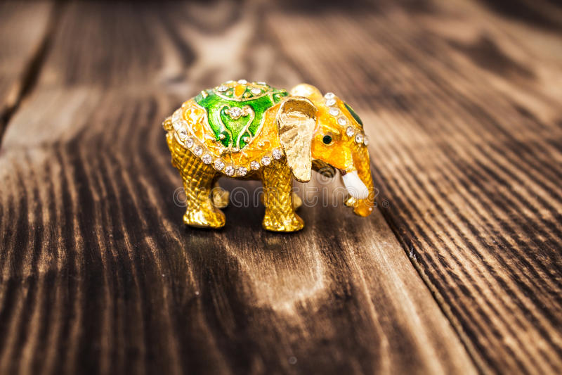 Gold elephant with stones handmade royalty free stock photos
