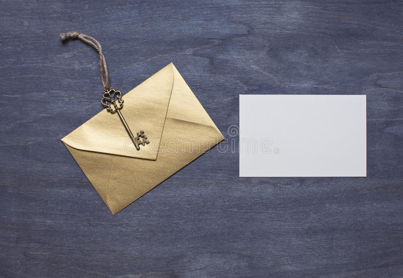 Gold envelope with key and invitation card stock image image of download gold envelope with key and invitation card stock image image of invitation mockup stopboris Choice Image