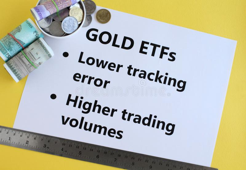 Gold Exchange Traded Funds or ETFs Indian Investment Concept. Gold exchange traded funds, or ETFs, an investment in Indian rupees concept, highlighting two of stock photography