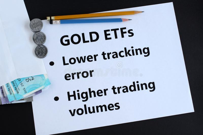 Gold Exchange Traded Funds or ETFs Indian Rupees Investment Concept. Gold exchange traded funds, or ETFs, an investment in Indian rupees concept, highlighting royalty free stock image