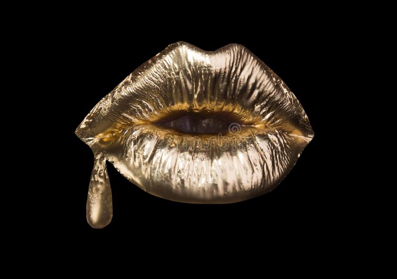 Gold expensive lips, girl sexy mouth background. Golden lipstick with drop of gold. Glamour fashion cosmetic for woman royalty free stock photos