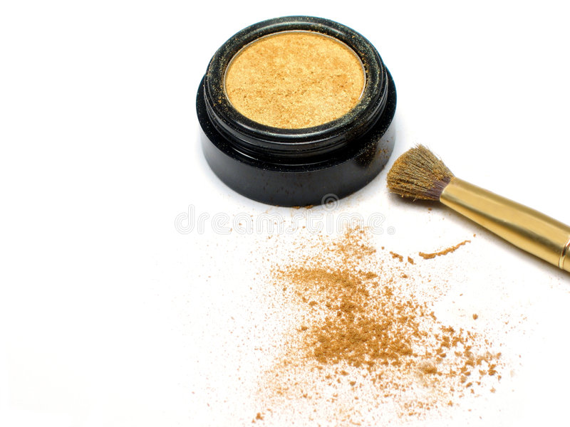 Gold Eyeshadow. And applicator brush stock images