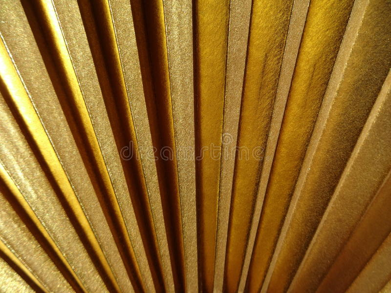 Gold fan texture. Gold color fan light and shade texture stock photos