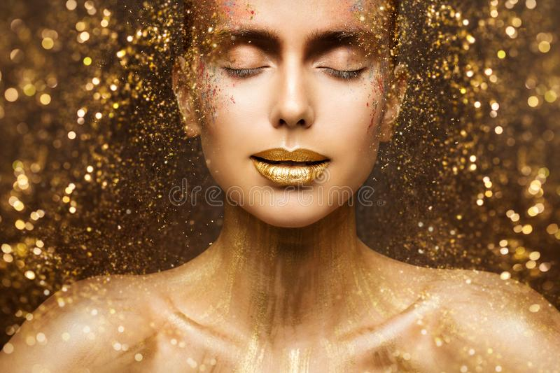 Gold Fashion Makeup, Art Beauty Face and Lips Make Up in Golden Sparkles, Woman Dreams royalty free stock photography