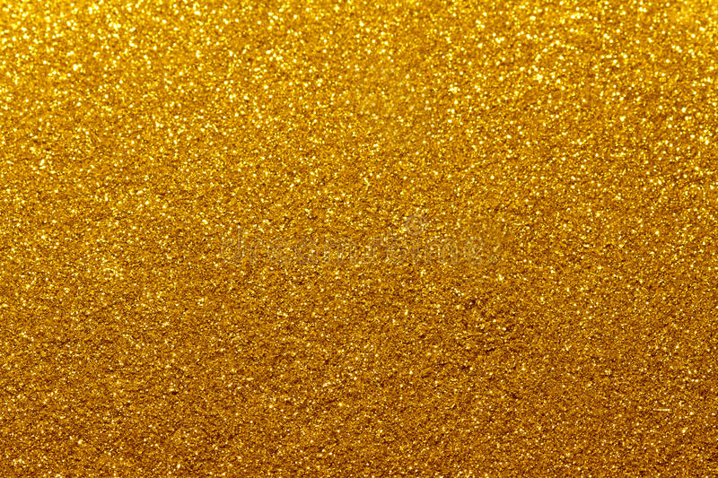 Gold Festive Christmas background. Abstract twinkled bright background with bokeh defocused golden lights stock photos