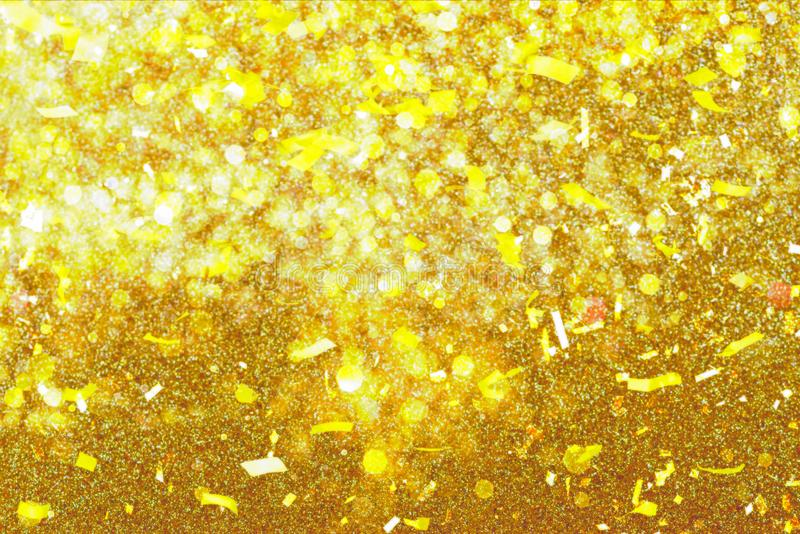 Gold Festive Christmas background. Abstract twinkled bright background with bokeh defocused golden lights. royalty free stock image