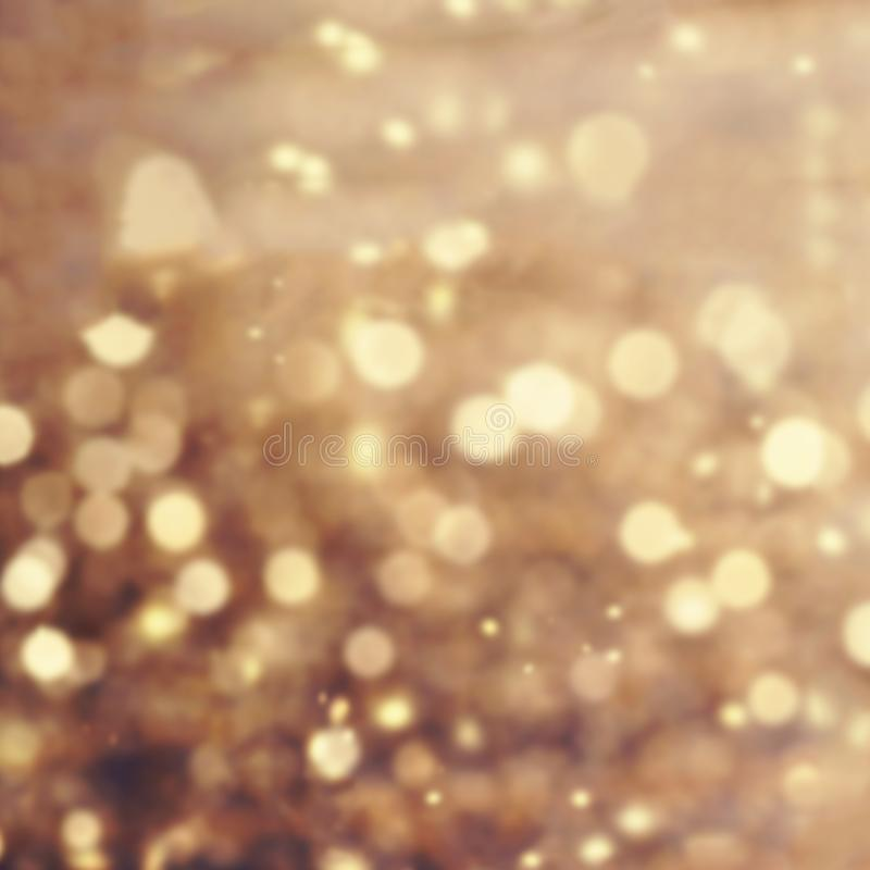 Gold Festive Christmas Fairy background. Abstract twinkled bright background with bokeh defocused golden lights. Gold Festive Christmas Fairy background royalty free stock photo