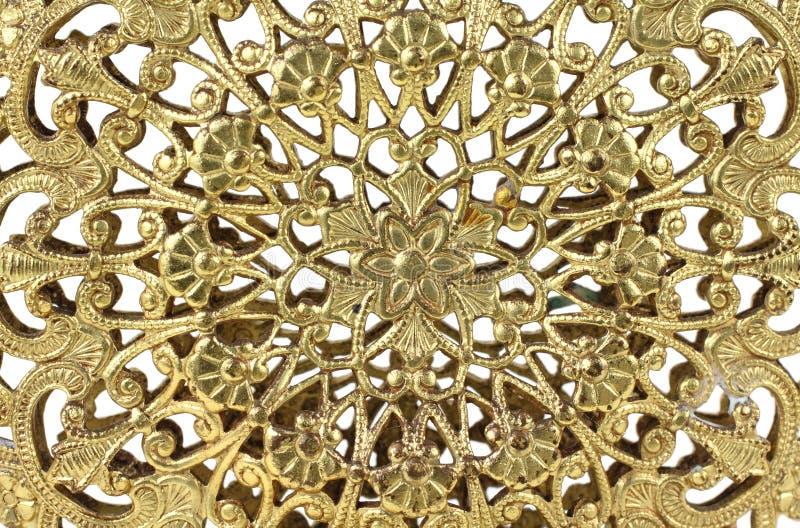 Gold filigree. Close view of delicate gold filigree design stock photos