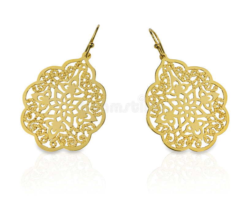 Gold Filigree Earrings. Isolated on a white background with a reflection stock photography