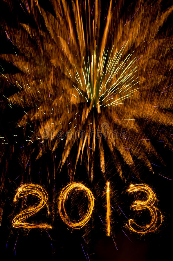 Gold fireworks and 2013 in sparkler writing