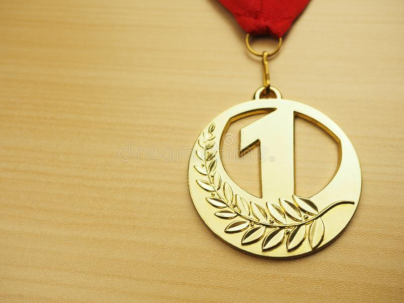 Gold first place winners medal. Success achievement concept.  royalty free stock images