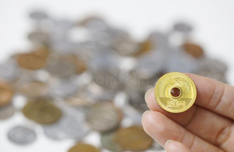 Gold Five Yen Coin Japanese on hand stock photos