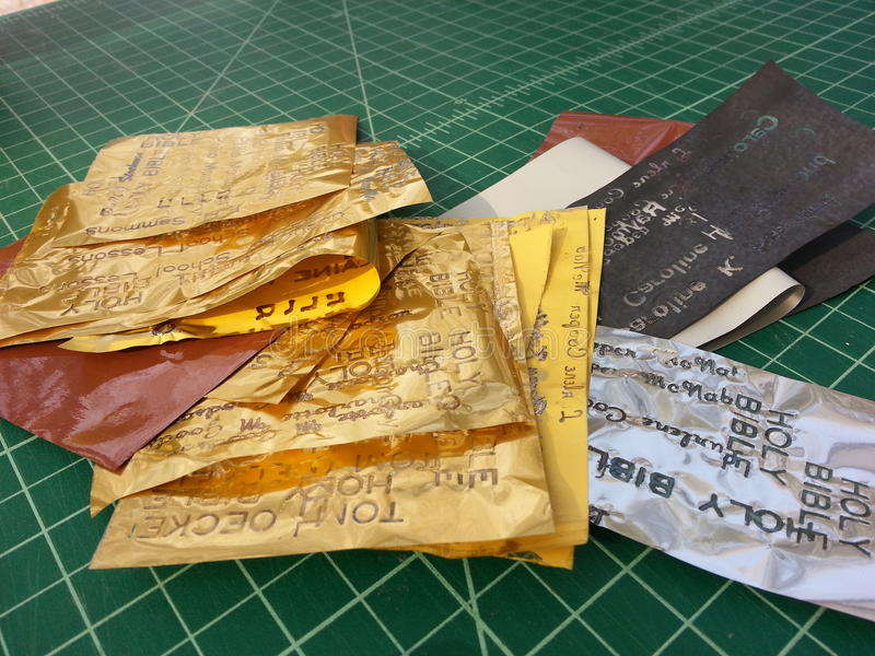 Gold foil in bookbinder's studio royalty free stock images