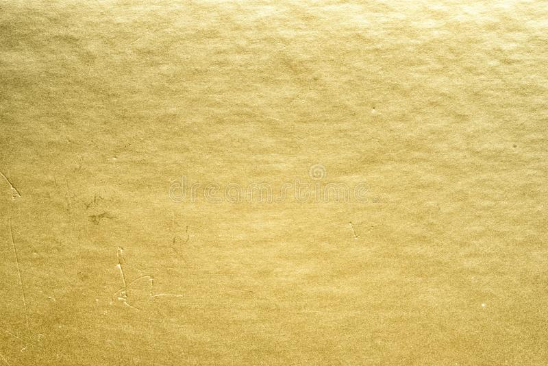 Gold foil. Shiny yellow leaf gold foil texture background