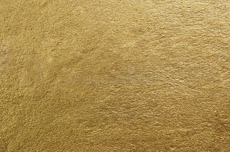 Gold foil texture. Golden abstract background. Close-up stock photography