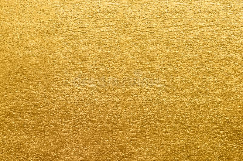 Gold foil texture. Golden abstract background. Close-up royalty free stock image