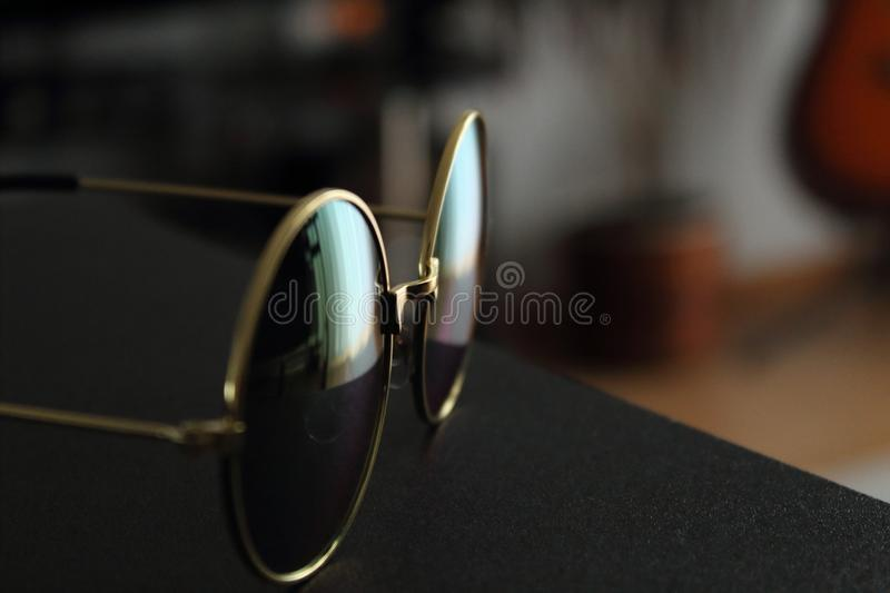 Gold Frame Black Lens Eyeglasses royalty free stock images