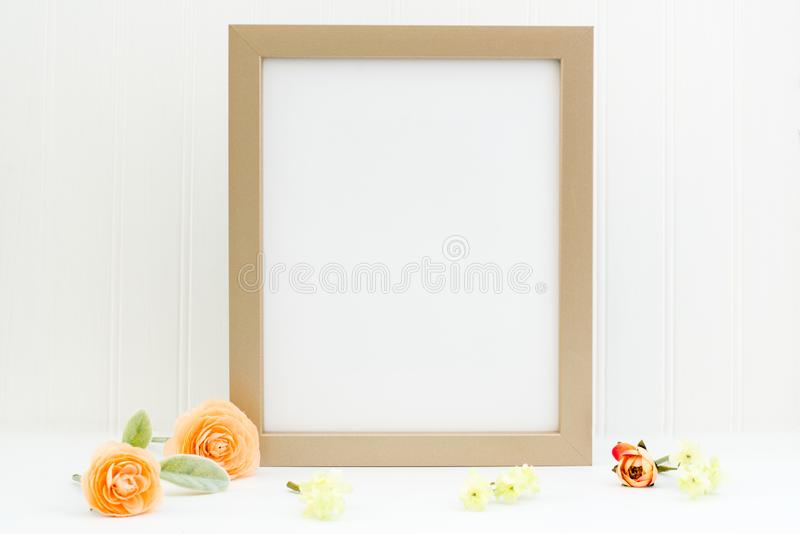 Gold frame mockup. Empty frame mockup on white background with flowers. Simple empty gold frame mockup. This is a 8x10 frame against a white wall. Peach and stock illustration