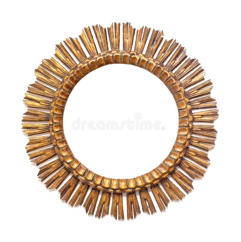 Gold frame in the shape of a round sun. Over a white wall stock image
