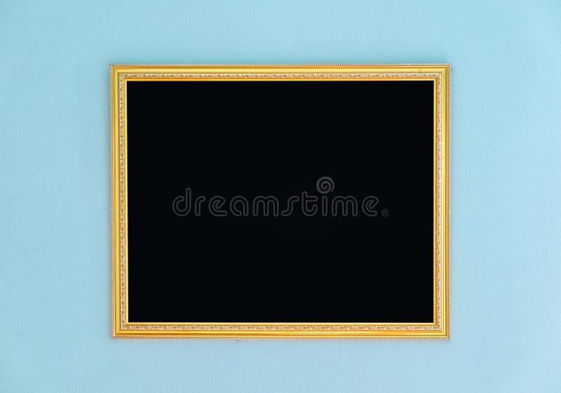 Gold frame tracery blank decor on wall stock image