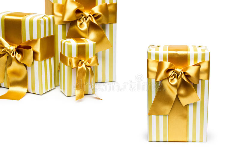 Gold gift boxes isolated on white royalty free stock photos